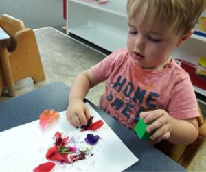 Toddler Montessori – Exploring the flowers while creating his Flower painting for Mother's Day cards!💖