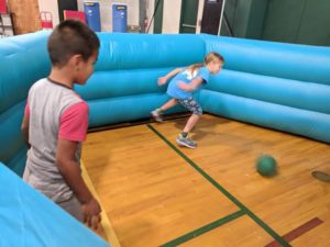 Elementary campers having a great time playing Gaga Ball in the Gym!