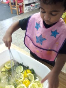 Enjoying sensory water play with lemons, limes and rosemary from the garden! Fine motors activities- scissor practice, pasting, grasping and pulling tape. Water pouring skill practice. Shape work!🍋🍈😊