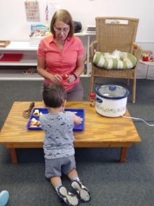 IHM Toddlers from Room 7 experiencing Practical Life cooking, making applesauce.🍎
