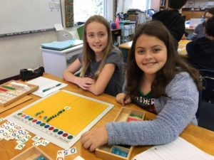 Fifth graders practice decimal board work!
