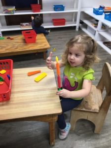 Room 7 Toddlers hard at work in their classroom. They really like their new floors too!?
