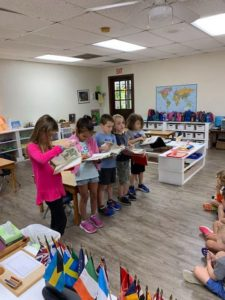 Room 12 first graders take their Reading Roadshow to Room 3. ??