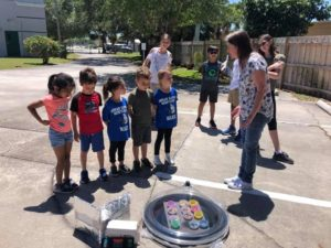 Checking out Room 22's Solar Oven.☀️