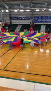 All of 3-6 playing popcorn with the parachute at gym time!🍿😊