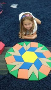 Room 12 First Graders are working hard! Geometry Patterns, Counting to 180, and Stripboard Subtraction.?